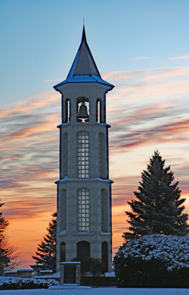 the Bellman Carillon Tower at sunrise with a light snow